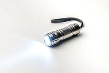 LED Flashlight On A White Background