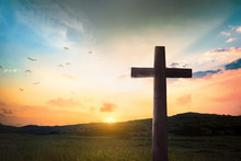 Religious Concept: Jesus Christ Wooden Cross With Dramatic Lighting Background