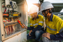 Workers Use Clamp Meter To Mea...