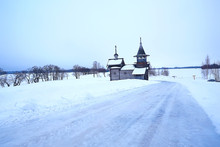 Lonely Wooden Church In The Field / Concept Faith, God, Loneliness, Architecture In The Winter Landscape