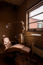 Derelict Medical Chair   Equipment - Abandoned Mayview State Hospital - Pittsburgh, Pennsylvania