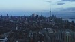 Aerial of downtown Toronto flying over Liberty village at dusk. DOLLY OUT