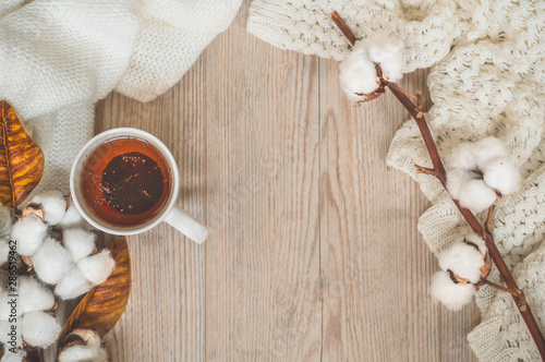 Fotomural  Background with warm sweaters and cup tea