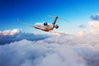 canvas print picture - Passengers private airplane flying above clouds