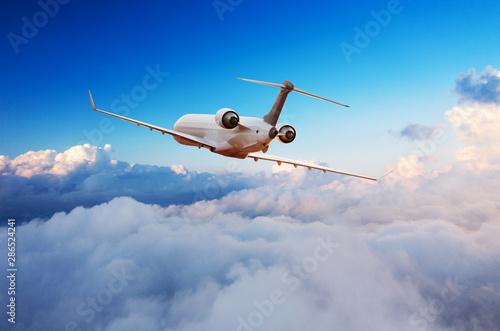 Passengers private airplane flying above clouds