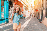 Fototapeta Uliczki - Young carefree girl walking in narrow streets of Lyon old town, Travel and lifestyle in France