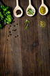 canvas print picture - spices and fresh salad on dark wooden table top view