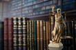 canvas print picture - Judge, justice concept background.  Symbol of justice – Themis in the old university library.
