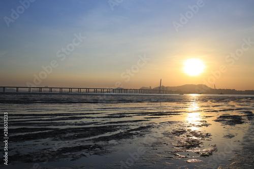 sunset of tidal beach and sunlit of chinese boat  Ha Pak Nai at Yuen Long Canvas Print
