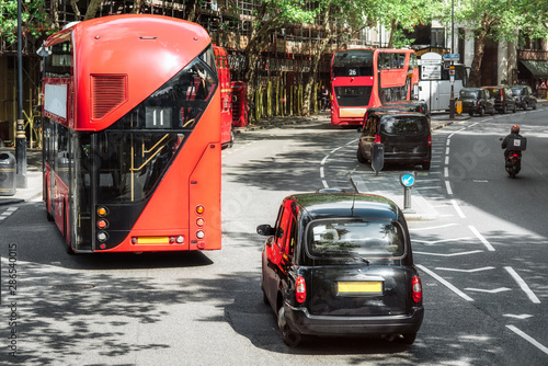 Tableau sur Toile London road traffic, double decker buses and traditional taxi, traditional vehicles of London city