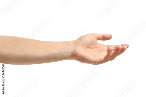 Young man held out hand on white background, closeup Wallpaper Mural