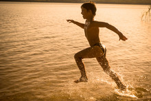 Boy Running On The Water With ...
