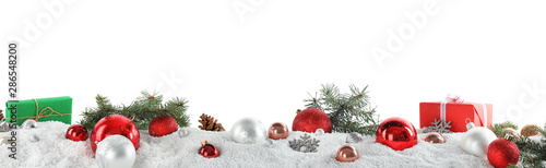 Canvastavla  Fir branches, Christmas decoration and snow against white background