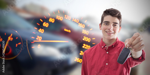 young man smiling with car keys