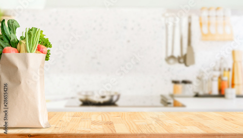 Wood table top on blurred kitchen background Fotobehang