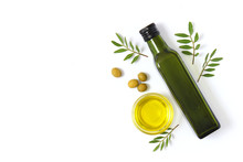 Olive Oil In A Bottle On A White Background Top View.