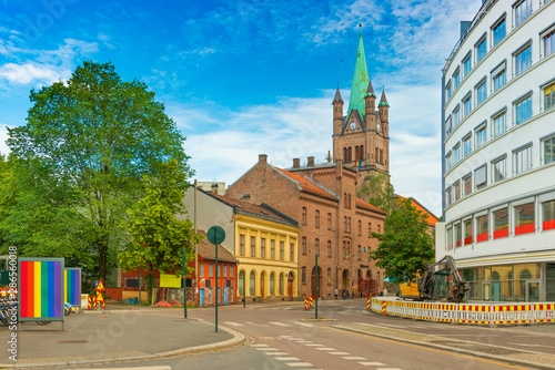 View of a street in Oslo and Greenland Church (Grønland Kirke) on Pride parade d Canvas Print