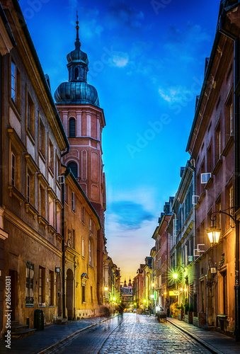 Fototapeta Warsaw old town street. Evening view of old houses and Church. Long exposure. Warsaw, Poland. obraz