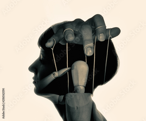 Vászonkép Marionette in woman head, black and white