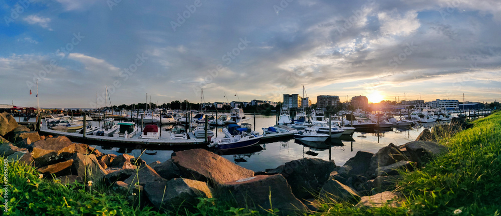 Fototapeta Golden hour sunset over harbor - panorama view of Harbor View, Stamford City, Connecticut