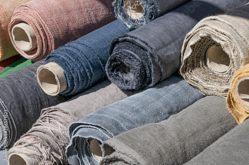 Obraz Rolls of linen canvas textile on market stall - fototapety do salonu