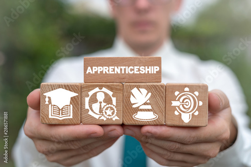 Apprenticeship on wooden blocks as education or job training concept Canvas Print