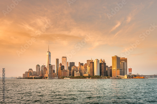 Fototapety, obrazy: New York City New Jersey, NYC/ USA - 08 21 2017: Amazing sunset on New York City Hudson River on public transport staten island ferry with beautiful panorama view to NYC Manhattan skyline