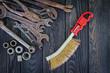 Rusty Old Tools on black vintage wood background.
