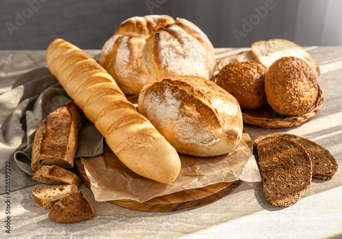 Assortment of fresh bread on table Canvas Print