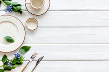 White Plates And Flowers For Table Setting Frame On White Wooden Background Top View Mockup