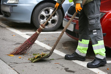 Garbage Man Brooming The Leaves