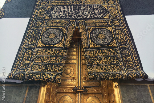 MECCA, SAUDI ARABIA - September 2019. The door of the Kaaba holy mosque Al-Haram in Mecca Saudi Arabia. Muslim pilgrims from all over the world gathered to perform Umrah or Hajj.