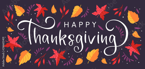 Obraz na plátne  Background with colorful autumn leaves and hand drawn lettering Happy Thanksgivi