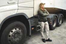 Portrait Of Truck Driver Looki...