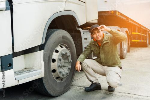 Fotografie, Obraz  Portrait of truck driver happy smile with a semi truck.