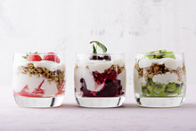 Healthy Dessert With Whipped Cottage Cheese, Granola, Strawberries, Cherries And Kiwi On Pink Background