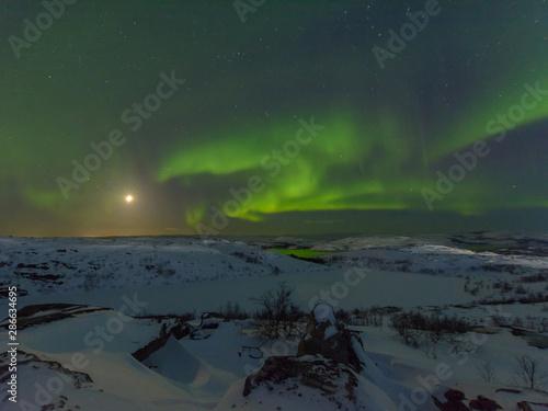 Fényképezés Northern lights, aurora in the sky at night