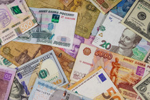 Multicurrency Background Of Euros US Dollars, Russian Rubles, Egyptian Pounds And Ukrainian Hryvnias