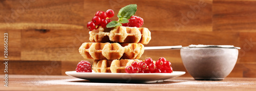 Fotomural Traditional belgian waffles with fresh mint, sugar and raspberries on table