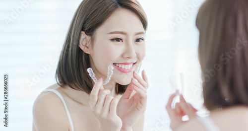 Obraz Asian woman with invisible braces - fototapety do salonu
