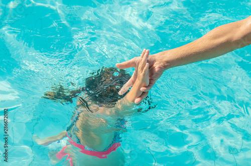 kid is drowning in the sea. Selective focus. Fototapeta