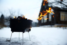 Small Brazier With Coals In The Snow In Winter