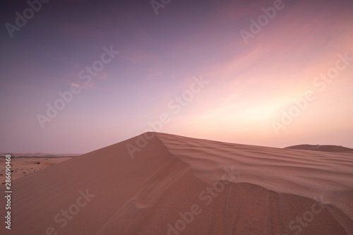 Poster Abou Dabi Sun set in dessert outside of Abu Dhabi with pink and red sky UAE