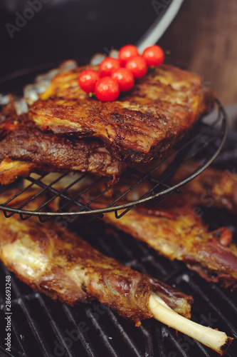 Fototapety, obrazy: The chef is cooking meat on the grill. Golden rib steaks and chicken with grilled vegetables, delicious food