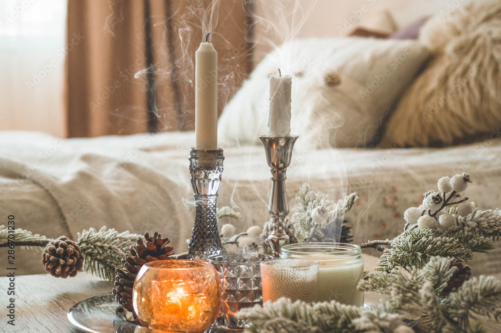 Fototapety, obrazy: A lot of candles with candlesticks on the home background. Home and home decor. Candles flame. HOME concept