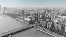 Aerial View Of London With Westminster Bridge, Palace Of Westminster And Big Ben Being Renovated In The Distance. Black And White