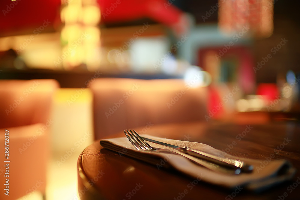 Fototapeta table setting restaurant / cutlery on a table in a cafe, the concept of beautiful food, European style