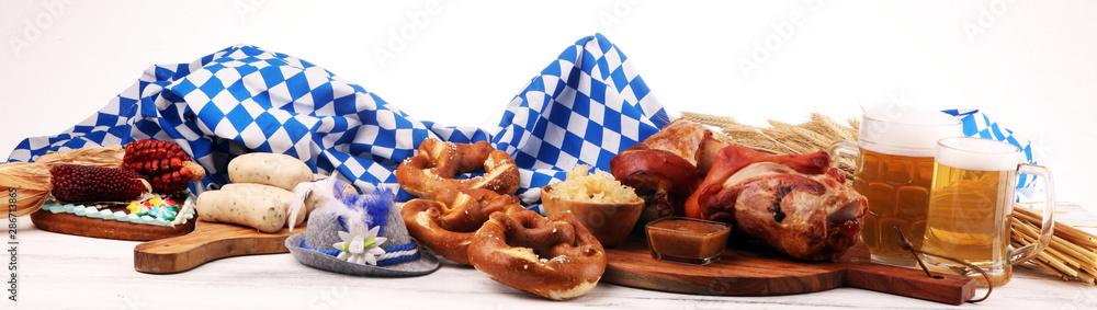 Fototapety, obrazy: Traditional German cuisine, Schweinshaxe roasted ham hock. Beer, pretzels and various Bavarian specialties. Oktoberfest background