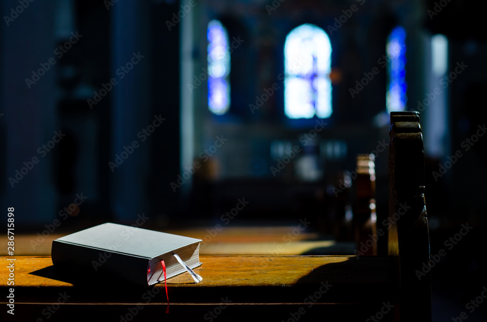 Fototapety, obrazy: Bible lies on Kneelers in the Church.