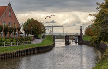 A Canal With A Drawbridge In T...